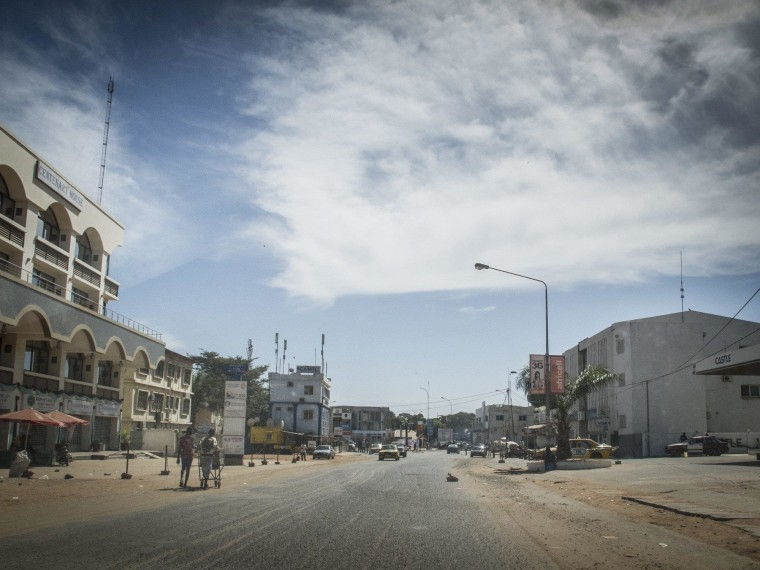 Image: Residents walk on an empty street in Banjul Gambia, Tuesday, Dec. 30, 2014.