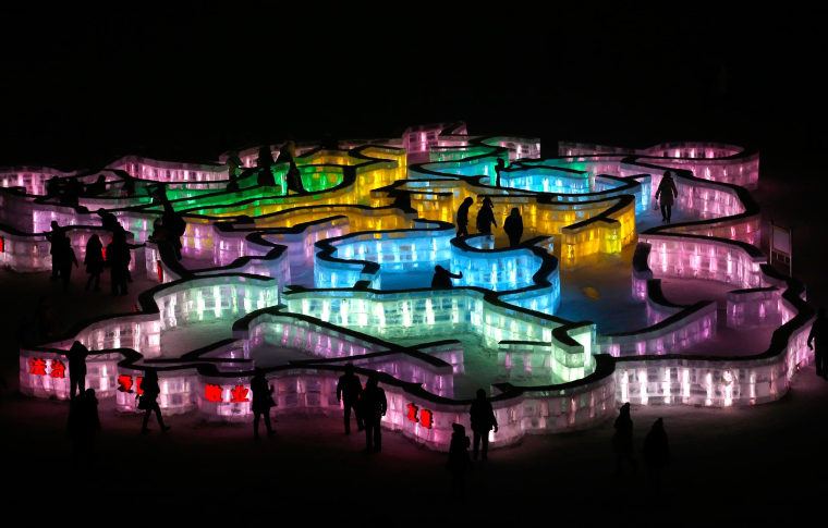 People visit an ice maze at the 31st Harbin International Ice and Snow Festival in the northern city of Harbin, Heilongjiang province, January 4, 2015.