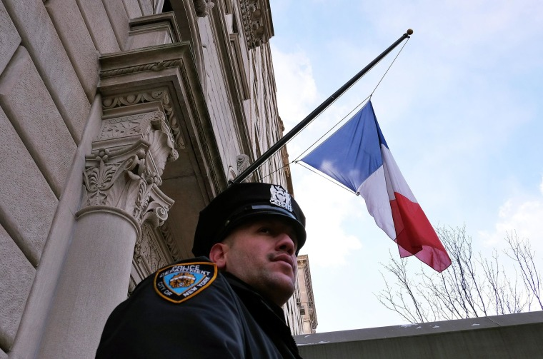 A New York Police Department (NYPD) officer guards the French consulate in New York on January 7, 2015, following an attack by unknown gunmen on the office of the weekly Charlie Hebdo in Paris. Heavily armed gunmen shouting Islamist slogans stormed a Paris satirical newspaper office on January 7 and shot dead at least 12 people in the deadliest attack in France in four decades. A