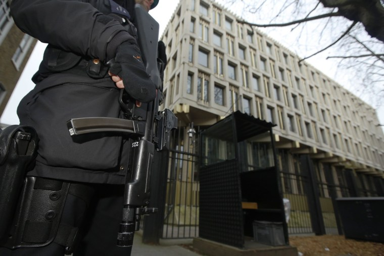 Image: A police officer patrols outside the U.S. embassy in London