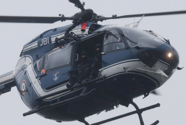 A French police flies over Dammartin-en-Goele where a hostage-taking was underway after police hunting the Islamist brothers who killed 12 people earlier this week exchanged fire with two men during a car chase on Jan. 9, 2015.