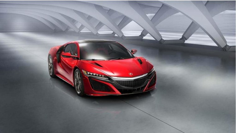 Acura unveils the 2016 NSX, a 2-seater supercar hybrid, at The North American International Auto Show in Detroit.