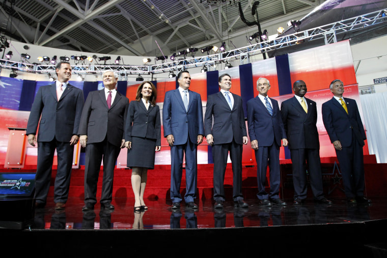 Image: Santorum, Gingrich, Bachmann, Romney, Perry, Paul, Cain, and Huntsman stand before the start of the GOP presidential primary debate in Simi Valley