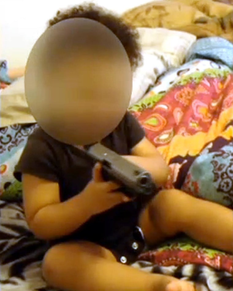 An Evansville, Ind. couple is in jail after police found two videos of a 1-year-old boy playing with a .40 caliber handgun.
