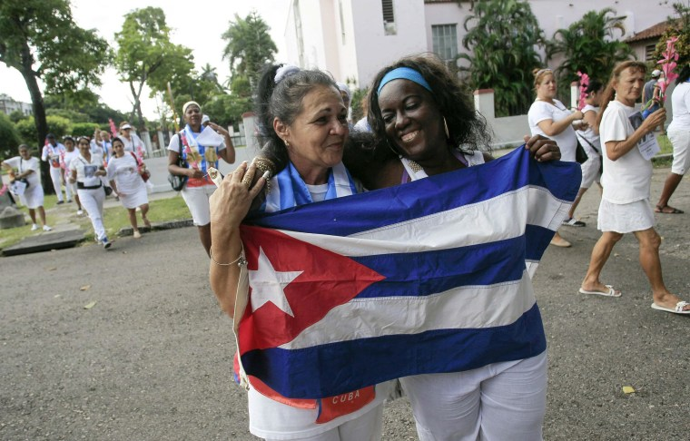 Recently released dissidents Aide Gallardo (L) and Sonia Garro hold the Cuban national flag during a march in Havana January 11, 2015. Cuba has released all 53 prisoners it had promised to free, senior U.S. officials said, a major step toward détente with Washington. The release of the remaining prisoners sets a positive tone for historic talks next week aimed at normalizing relations after decades of hostility, the officials said.