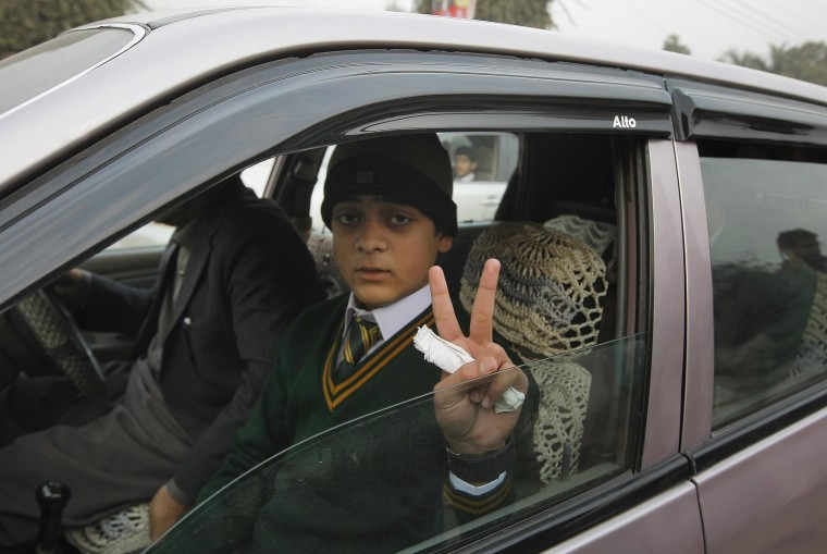 Image: Mohammad Baqair, who survived the Taliban attack on a school that killed his mother