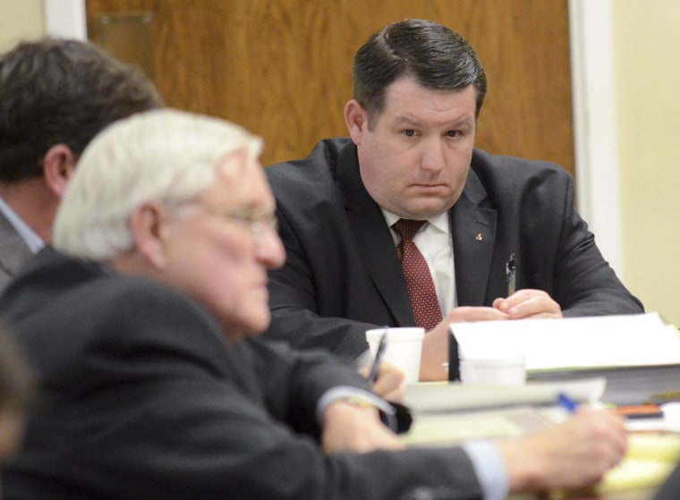 Former Eutawville Police Chief Richard Combs sits with lawyers on the second day of testimony in his trial for the murder of Bernard Bailey in Orangeburg, South Carolina January 8, 2015. Combs, 38, faces up to life in prison if convicted of killing Bernard Bailey, 54, in the town hall parking lot in Eutawville, a town of about 300 people southeast of Columbia.  REUTERS/The Times and Democrat/Larry Hardy/Pool  (UNITED STATES - Tags: CRIME LAW)