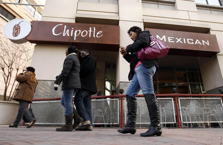 Image: File photo of pedestrians passing a Chipotle Mexican restaurant in Arlington