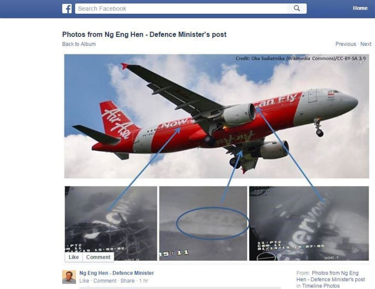 Image from the Facebook page of Singapore's defense minister show images of he fuselage of the AirAsia plane found in the Java Sea.