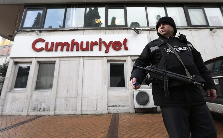 Image: Security guard outside Turkish daily newspaper Cumhuriyet