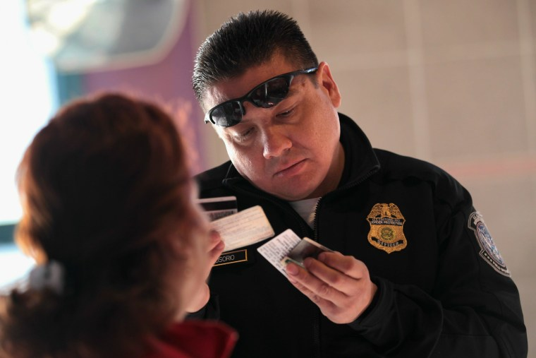 U.S. Customs screen citizens crossing into Arizona from Mexico  John Moore / Getty Images file