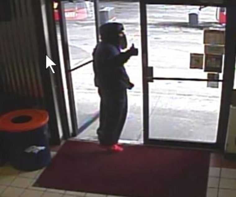 IMAGE: Thumbs-up robber