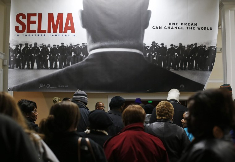 "Image: Audience members line up for a screening of the movie ""Selma"" at the Selma Walton Theatre in Selma"