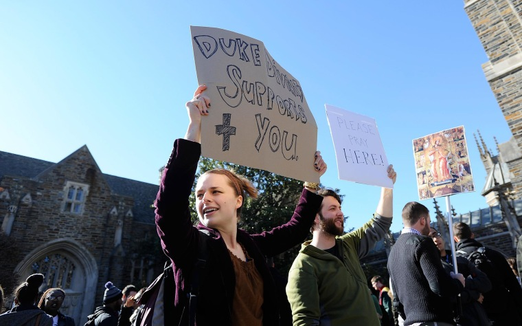 Image: Duke Divinity graduate students Sarah Martindell and Elliott Smith show support for Duke Muslims