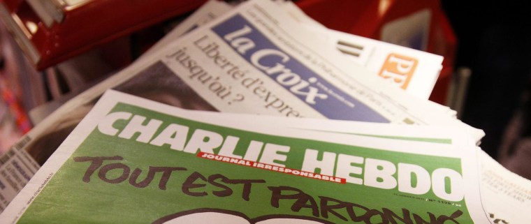The new edition of the French satirical magazine Charlie Hebdo is on sale at Gare de Lyon train station, in Paris on Jan. 14. Asian and Muslim satirists and writers have been at the forefront of a new conversation in the wake of the attack at the magazine's office, challenging the limits of free speech.