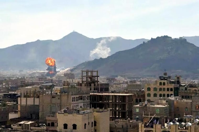 A general view shows smoke and flames rising during heavy clashes between presidential guards and Shiite Houthi rebels in Sanaa, Yemen, on Jan. 19, 2015. EPA/STRINGER