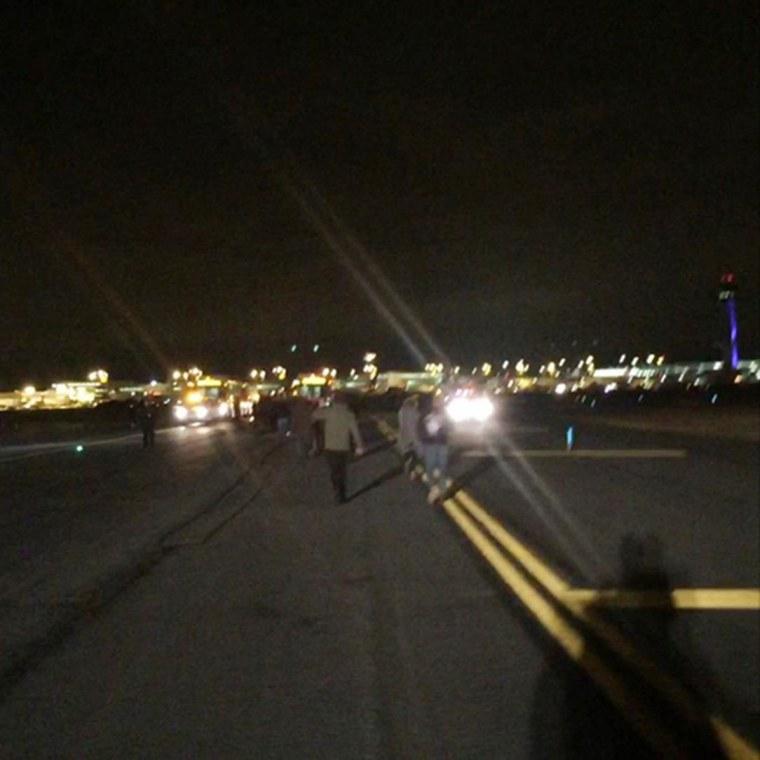 Image: Passengers exit Delta Flight 468 at JFK after arriving from San Francisco