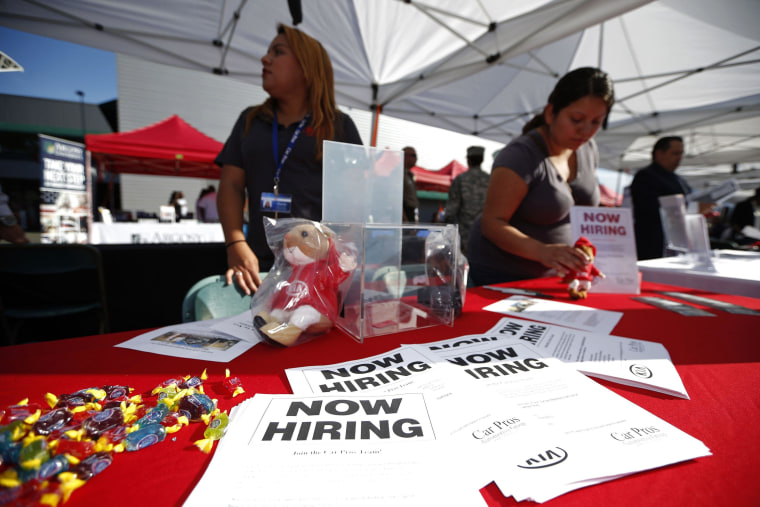 Image: Recruiters wait at a booth at a military veterans' job fair in Carson