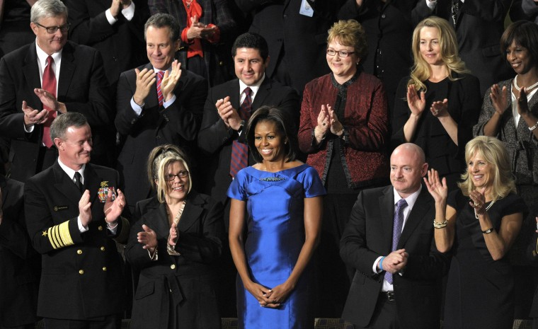 Guests applaud first lady Michelle Obama during the State of the Union address in 2012.