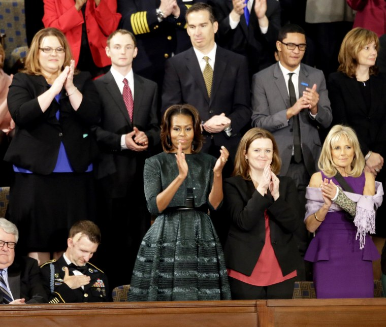 First lady Michelle Obama applauds during the State of the Union address in 2014.
