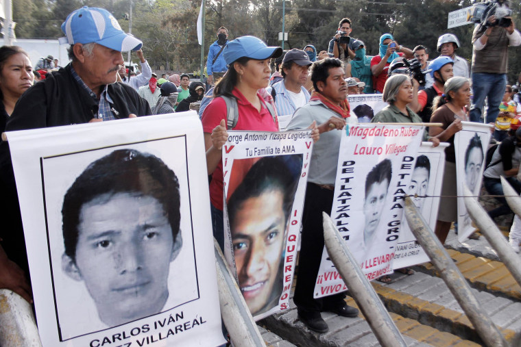 Image: Parents of  missing students participate in a protest demanding justice and clarification of the disappearance of 43 students from Ayotzinapa