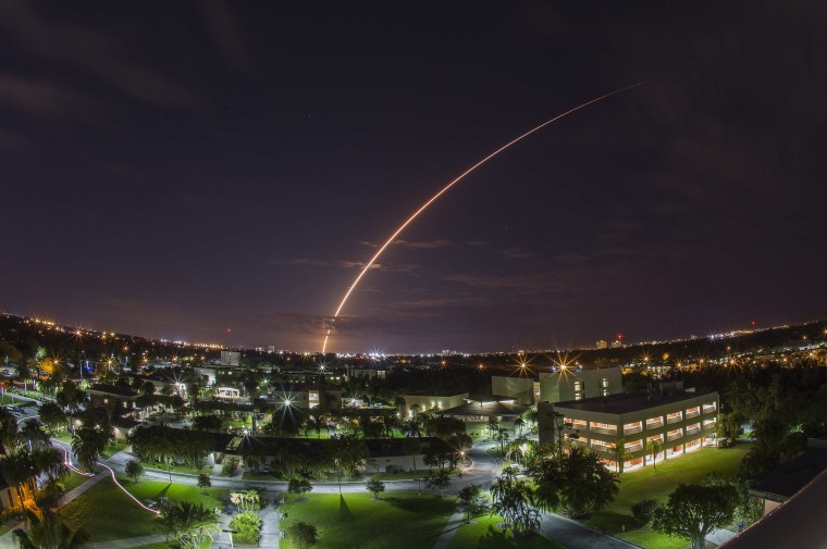 A United Launch Alliance Atlas 5 rocket blasts off from Cape Canaveral Air Force Station in Florida on Tuesday. The rocket sent up a next-generation communications satellite designed to provide cellular-like voice and data services to U.S. military forces around the world. This long-exposure view looks over the campus of the Florida Institute of Technology in Melbourne, about 40 miles from the launch pad.