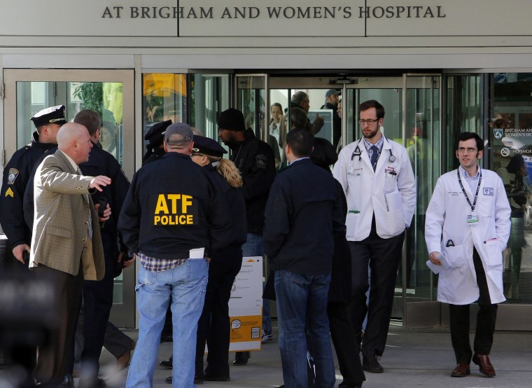 Local, state and federal law enforcement officials gather outside where a shooting occurred at Brigham and Women's hospital in Boston, Massachusetts, on Jan. 20, 2015.