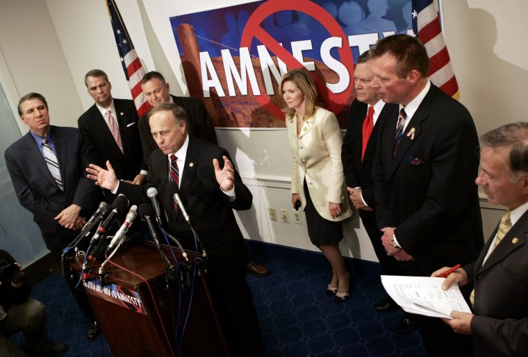 Surrounded by fellow House members, Rep. Steve King (R-IA) speaks out against any guest-worker legislation for immigrants during a news conference on Capitol Hill in Washington, in this March 30, 2006 file photo. King's high-profile role in the debate over President Barack Obama's executive order on immigration threatens Republican leaders' efforts to rebrand the party as more friendly to Hispanics, while his effort to block funding for the action raises the risk of a government shutdown. King and Representative Michele Bachmann, a fellow Tea Party activist, plan a news conference on December 3, 2014 to make their case that Obama has violated the U.S. Constitution by moving to shield 4.7 million undocumented residents from deportation if they have no serious criminal record. To match story USA-CONGRESS/SHUTDOWN-KING  REUTERS/Kevin Lamarque/Files  (UNITED STATES - Tags: CRIME LAW POLITICS BUSINESS EMPLOYMENT)