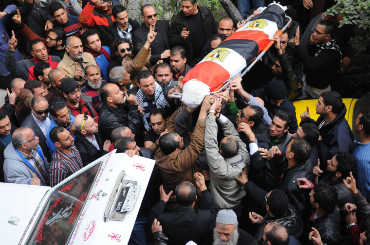 Image:Mourners carry the coffin of Shaima al-Sabbagh, an Egyptian protester who was killed in clashes with the police, during her funeral on January 25, 2015 in Egypt's second city Alexandria
