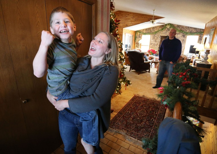 Image:  Nichole Gross plays with her son Chase, who is autistic and epileptic, at their home in Colorado Springs, Colo. Chase was moved from Chicago to Colorado so he could legally access a medical marijuana oil known as Charlotte's Web.