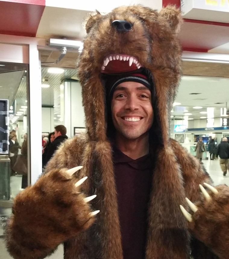 Cicero Goncalves of Queens dons grizzly bear garb he waits in New York's Penn Station for a train Sunday.