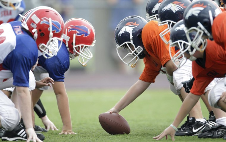 Image: Players line up during a 6th grade youth football game in Richardson, Texas