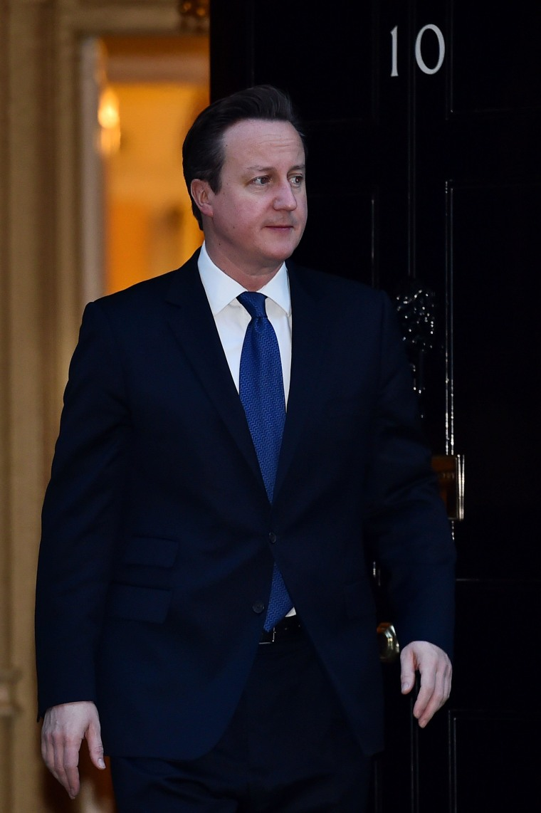 Image: British Prime Minister David Cameron comes to the step of 10 Downing Street