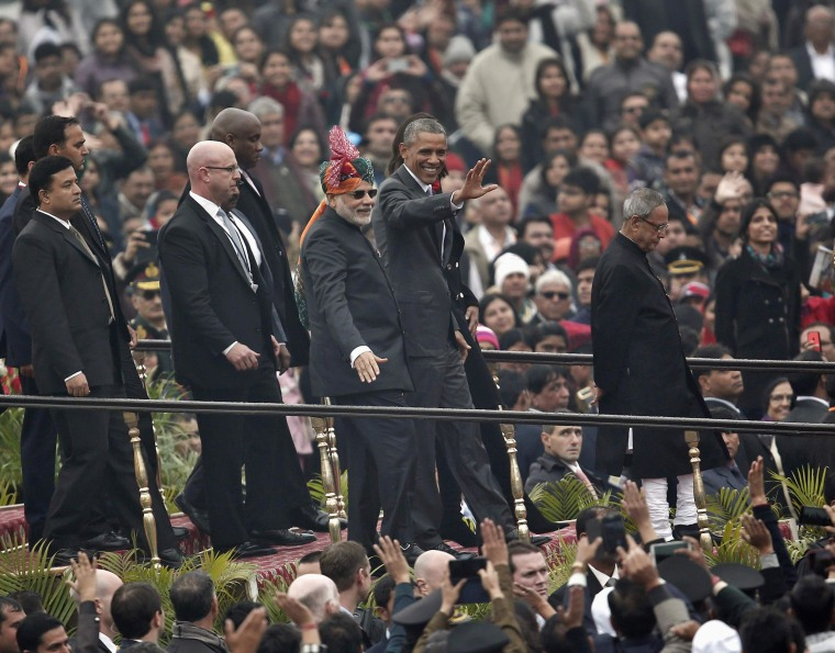 President Barack Obama is flanked by India's Prime Minister Narendra Modi (in turban) and Indian President Pranab Mukherjee as they leave after attending the Republic Day parade in New Delhi on Jan. 26. Obama watched a dazzling parade of India's military might and cultural diversity on Monday, the second day of a visit trumpeted as a chance to establish a robust strategic partnership between the world's two largest democracies.