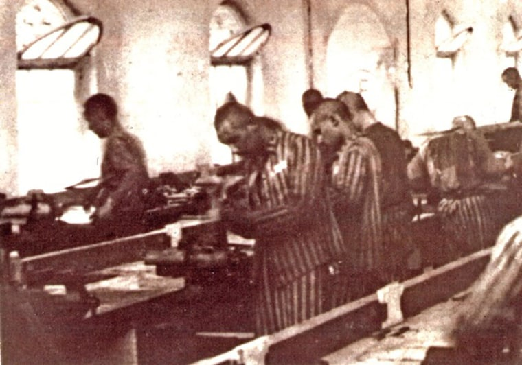 Image: Marcel Tuchman, in foreground, works as forced labor at a factory during World War II