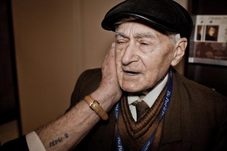 Image: Ihnat Neubauer of Ukraine is caressed by fellow survivor Leitner Dezso