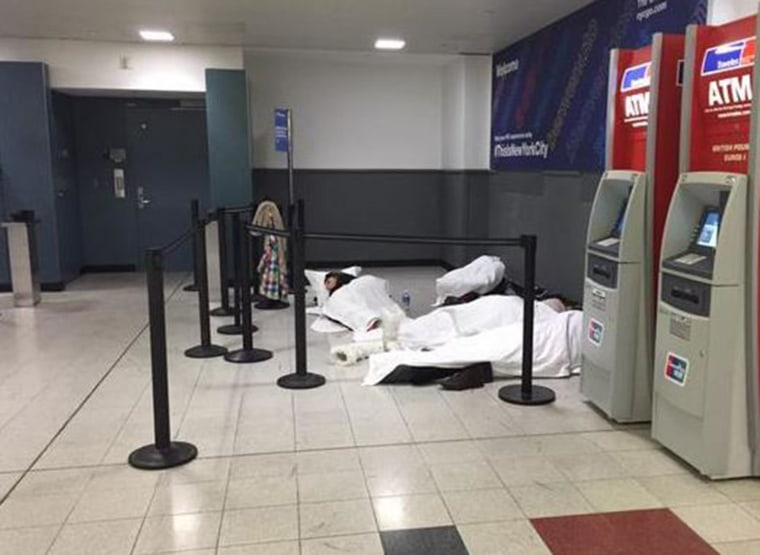 Passengers sleep on the floor at John F. Kennedy Airport after their flights were delayed.
