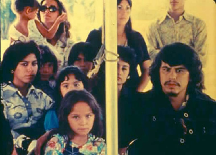 """A still from the movie """"Please, Don't Bury Me Alive""""s opening funeral scene. The movie's maverick director, Efraín Gutiérrez, is in the black shirt at the far right, playing the lead role of Alejandro."""