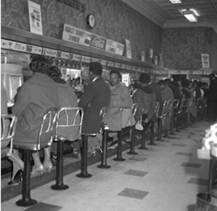 A number of Friendship students take their seats at a lunch counter in Rock Hill.