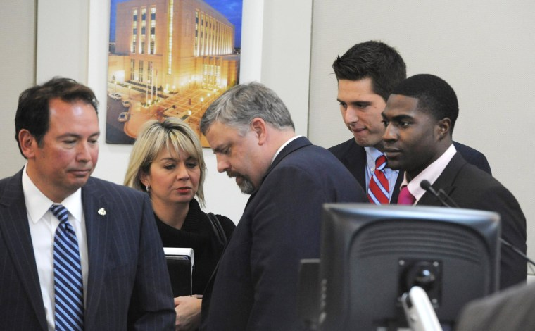 Image: The defense gatherers after the jury was read the charges against Brandon Vandenburg and Cory Batey