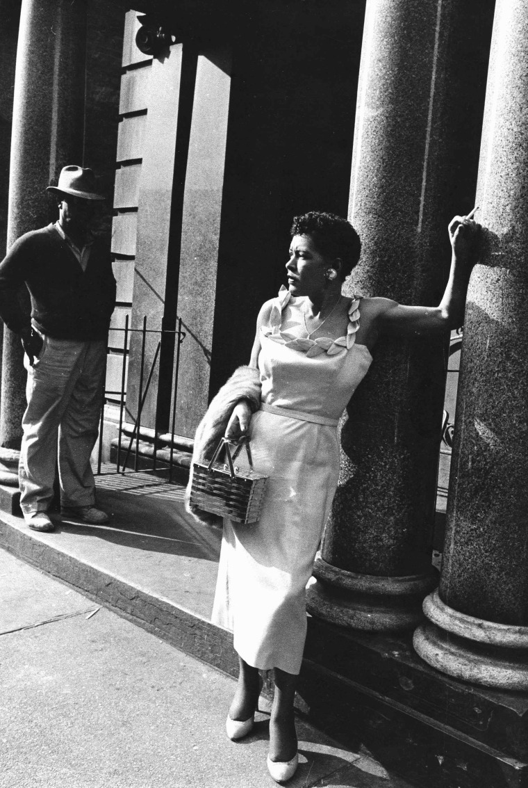 Image: Billie Holiday poses outside apartment house in 1956