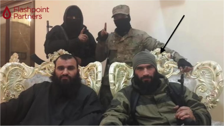 Image:  Abu Muhammad Al-Amriki, lower right, appears in ISIS video