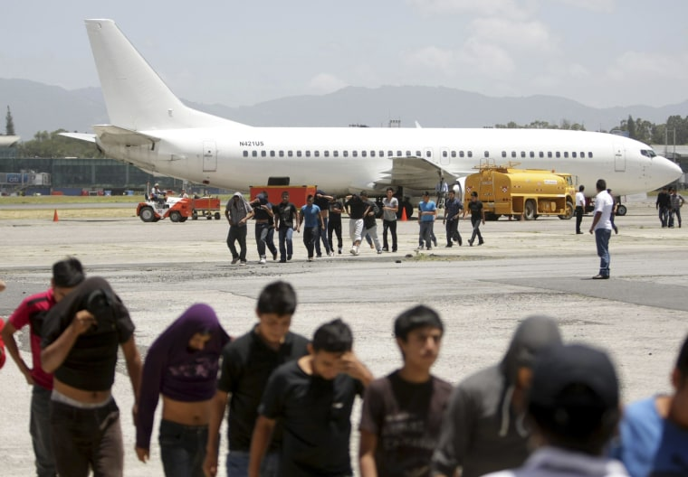 Image: Migrants from Guatemala who were deported from the U.S. arrive at La Aurora airport in Guatemala City