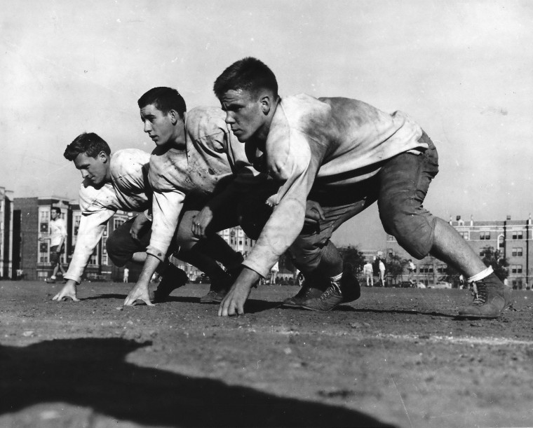 Carl Biesecker, middle, played football for all-white Horace Mann High School in Gary, Indiana. Following a 1944 game against the black school, Roosevelt High, he shook the hand of future NFL player George Taliaferro, cementing a friendship that set the stage for a tearful reunion earlier this week.