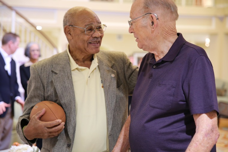 High-school football rivals Carl Biesecker and George Taliaferro are reunited after 60 years.