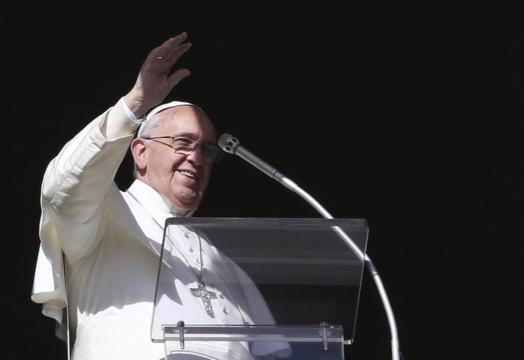 Image: Pope Francis waves during his Sunday Angelus prayer in Saint Peter's square at the Vatican