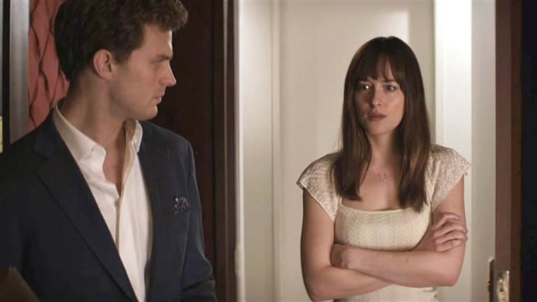 """Cannot be unseen: Christian's (Jamie Dornan) big reveal to Ana (Dakota Johnson) in """"Fifty Shades of Grey."""""""
