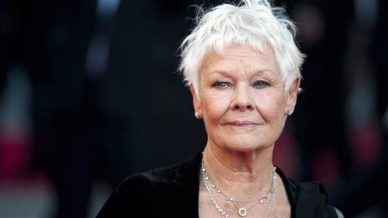 Dame Judi Dench, 80, is glamorous in gray.