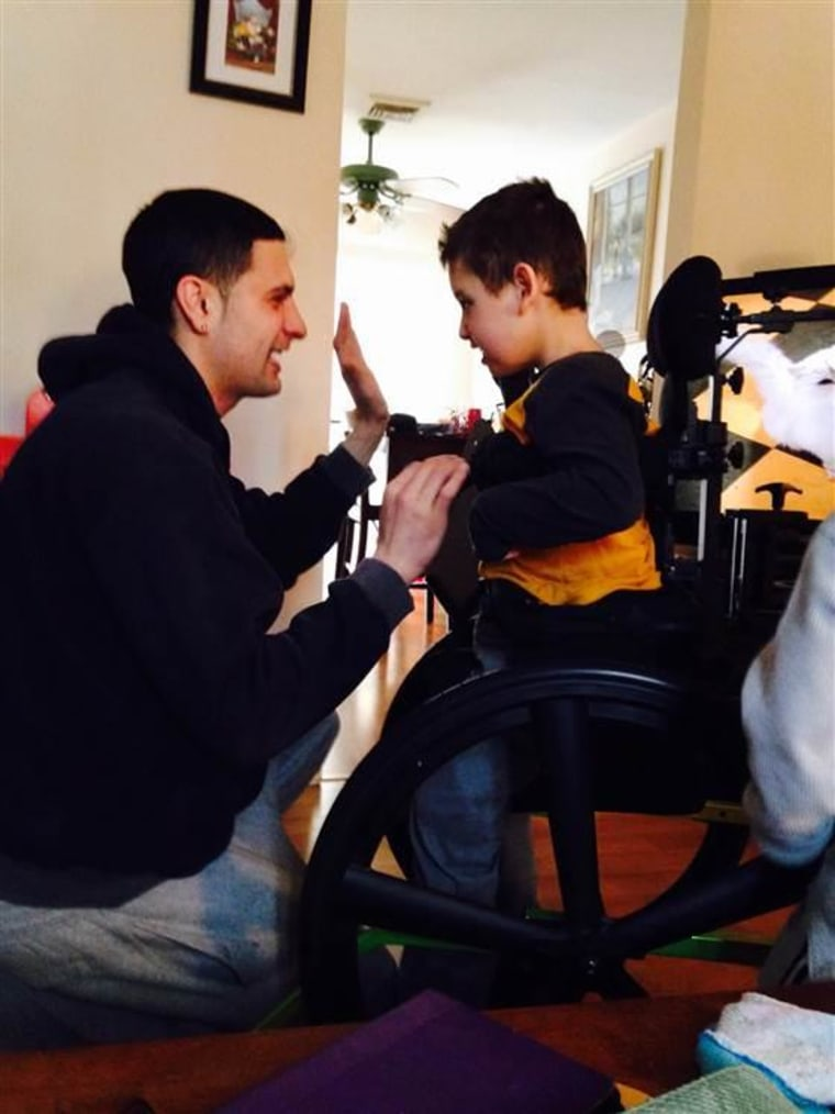 Jayce Correia shares a special moment with his stepson Jared.