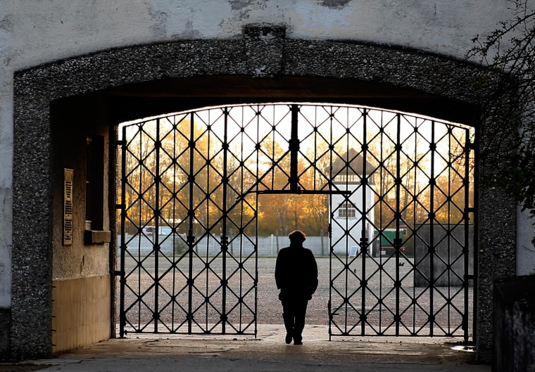 Image: A woman walks through the former Dachau concentration camp on Nov. 3